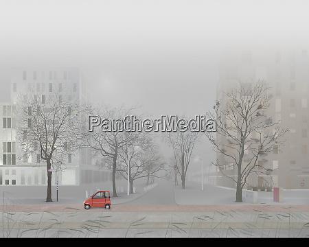 mann faehrt kleinwagen in leere nebelstrasse