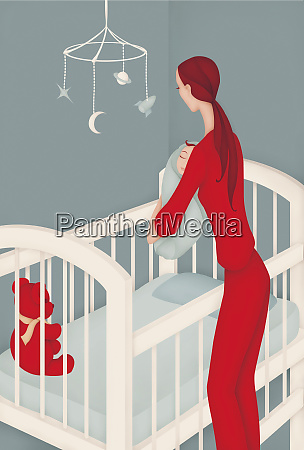 woman putting baby boy in crib