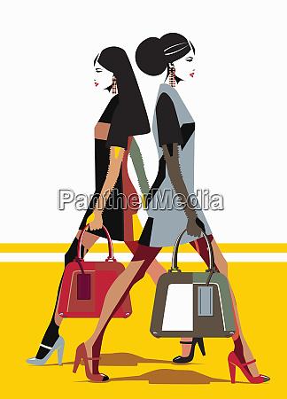 women wearing similar outfits walking in