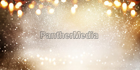 abstract bokeh background in gold and