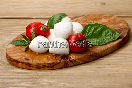 mozzarella heirloom tomatoes basil leaves on
