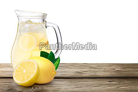 lemonade pitcher on wooden table