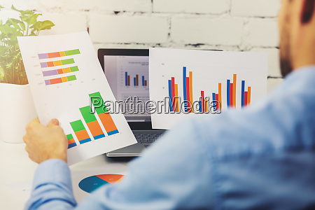 businessman analyzing business financial reports in