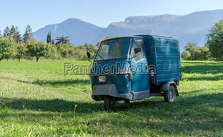 blue small transport vehicle on a