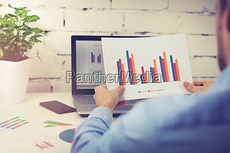 office worker analyzing financial business data