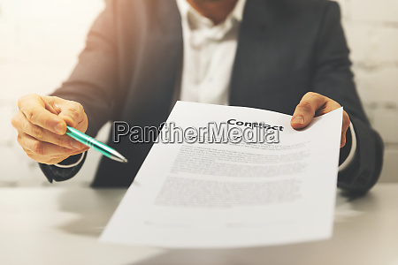 partnership businessman giving business contract