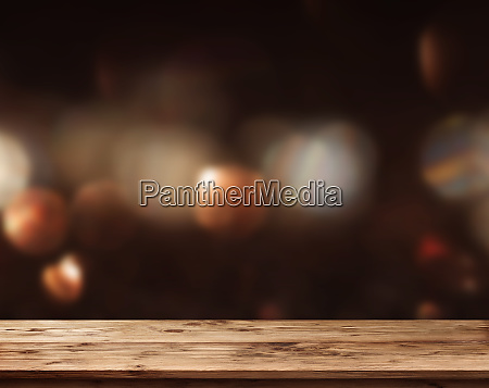wooden table with abstract dark background