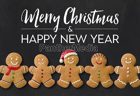 eine weihnachtskarte mit lebkuchenmaennern