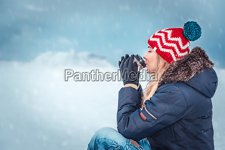 nice female having tea in cold