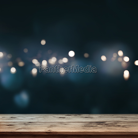 wooden table with dark blue background