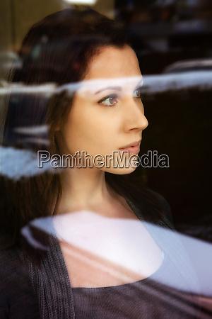 portrait of brunette woman looking through