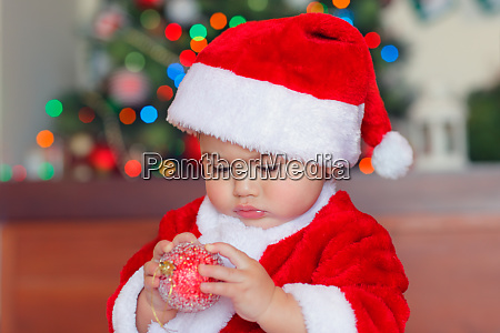 cute baby boy with christmas bauble