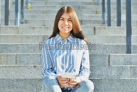 a young girl of asian appearance
