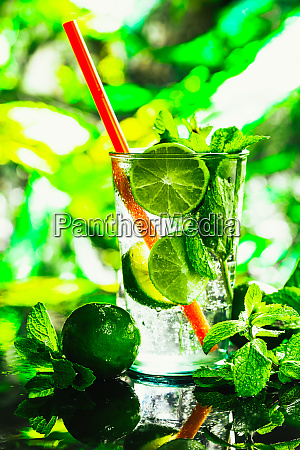 glass of mojito with lime and