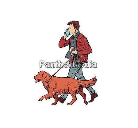 man walks with a dog golden