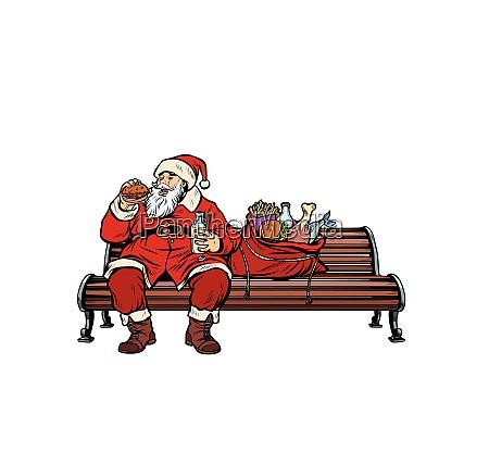 weihnachtsmann hungrig essen auf einer parkbank