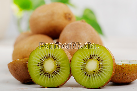kiwis on a white wooden table