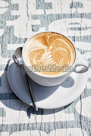 white cup of coffee with latte