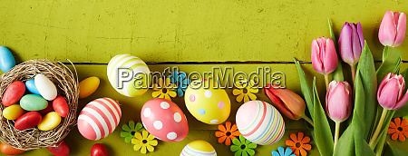 easter banner with eggs candies and