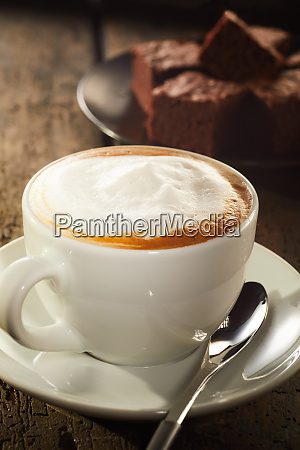 white cup of latte on saucer