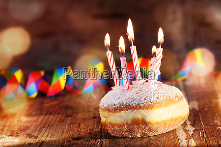donut with candles and carnival decoration