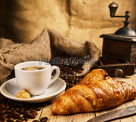freshly baked croissant with a cup
