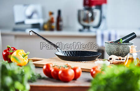 skillet or pan with a stone