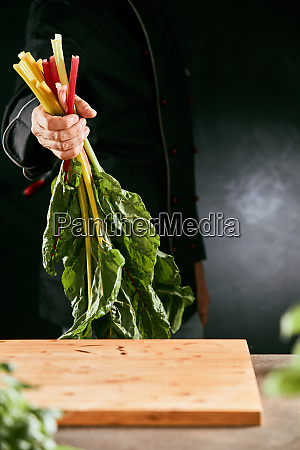 chef holding a handful of fresh