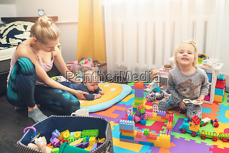 mother and children playing with toys