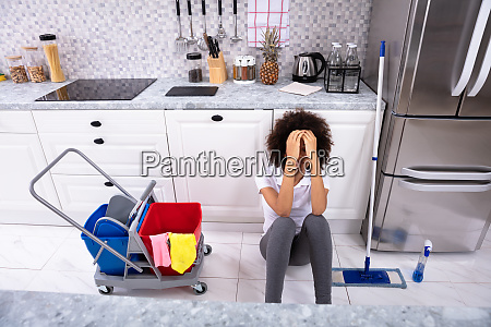 tired african young woman sitting in
