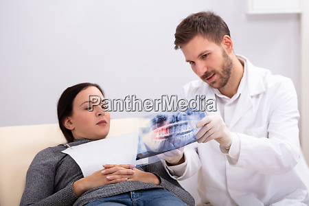 male doctor explaining x ray to