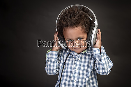 little boy wears big headphones