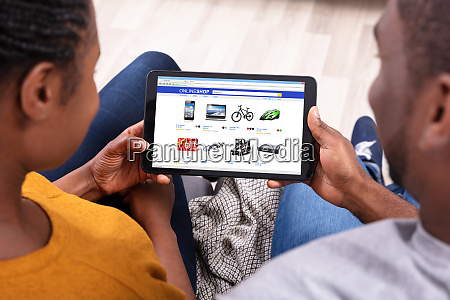 couple shopping online on digital tablet