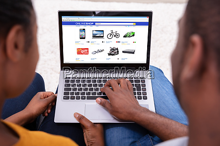 couple shopping online on laptop