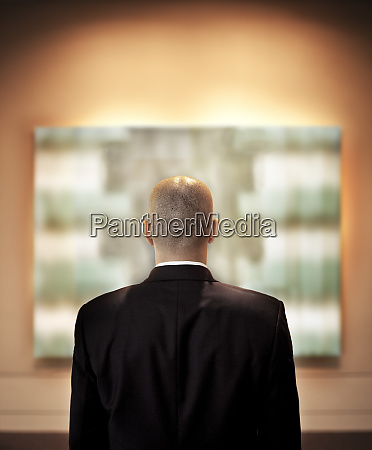 view from behind of a businessman