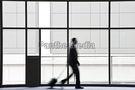 a businessman blurred in silhouette while