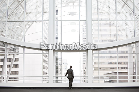 a businessman in silhouette standing at