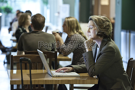 a caucasian businesswoman working on a