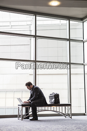 a businessman working on a laptop