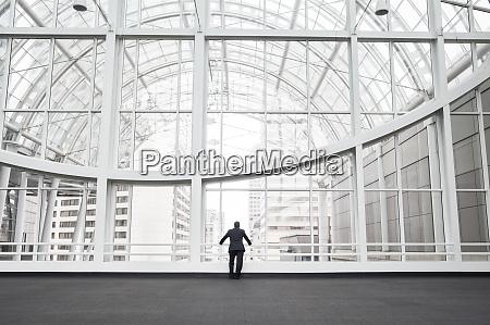 a man standing in an open