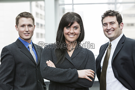 a group portrait of three business