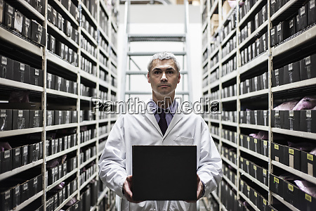 a caucasian male technician working on