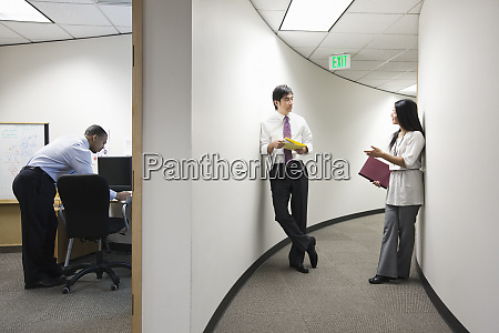 two asian businesspeople talking in a
