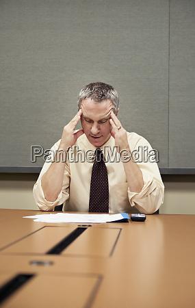 a caucasian businessman sitting at a