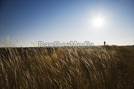a man walking along the edge