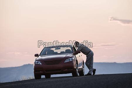 a senior caucasian man leaning in