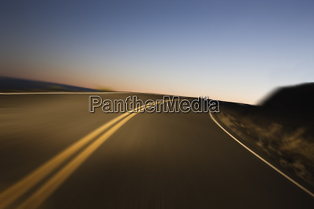 a blurred view of a road