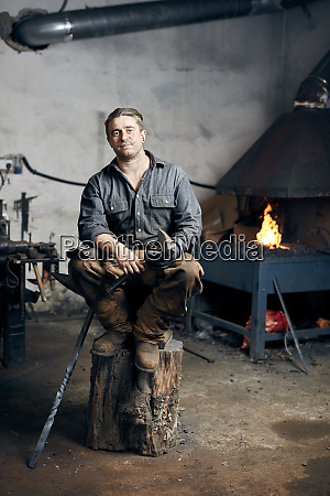 portrait of an artisan metalworker in