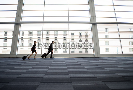 male and female business people running