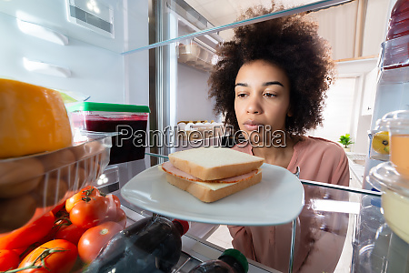 woman searching for food in the